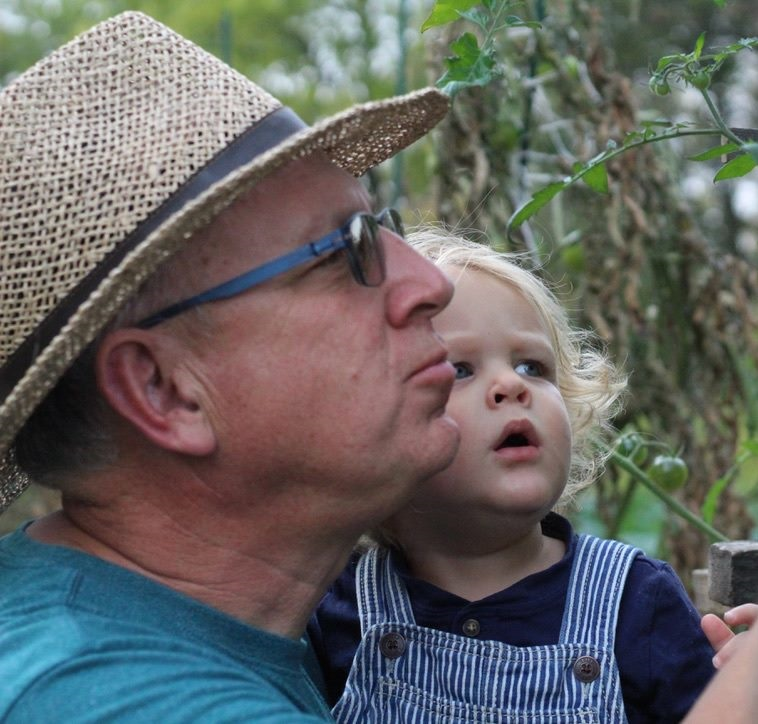Blue Eyes blog featured image. Photo of Jessie's father holding her son looking, both looking out at nature.