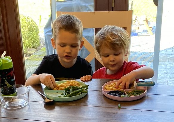 Stand Your Sacred Ground Blog featured image. Photo of Jessie's sons eating lunch.