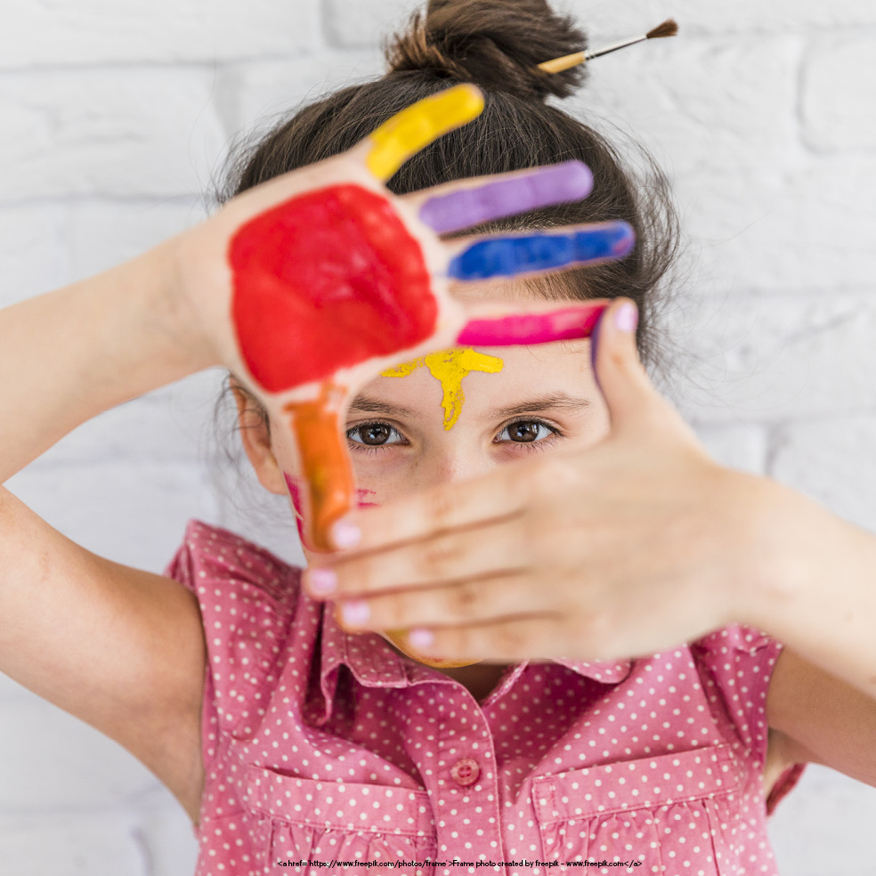 What Is ABA Therapy blog. Photo of a young girl with paint on her hands and face.