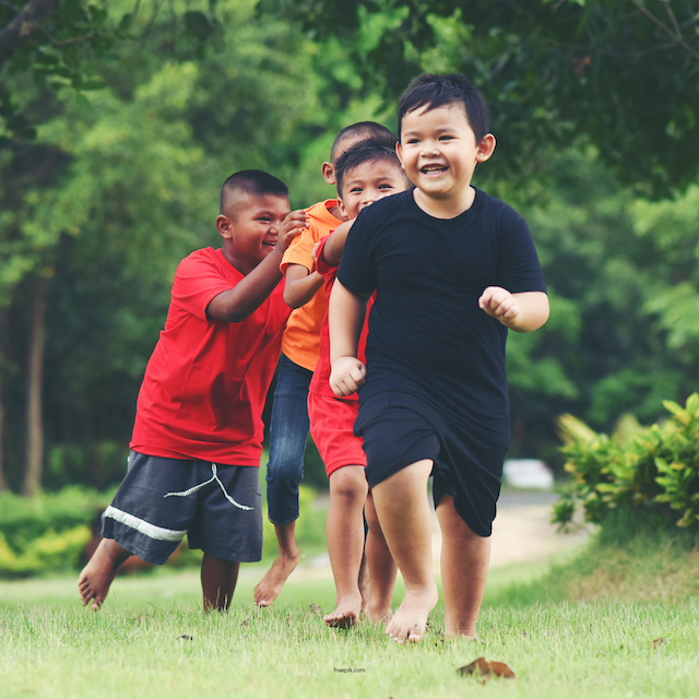 What is High Functioning Autism blog image. Photo of a bunch of young boys playing tag.