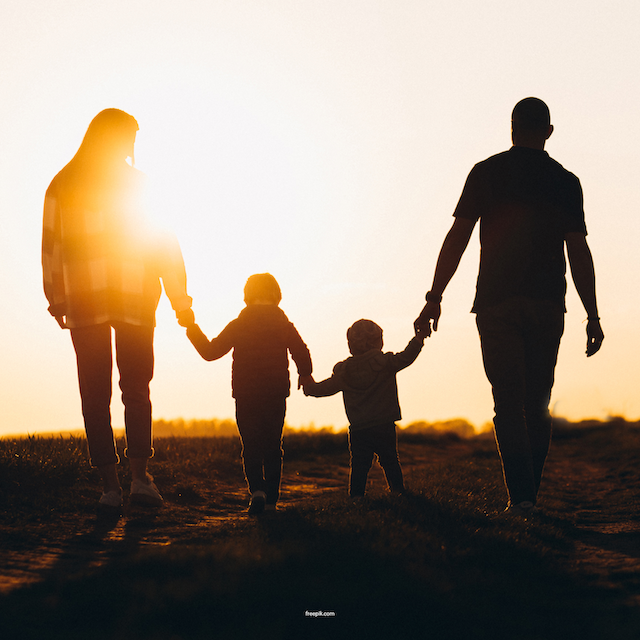 Why Whole Family Support for Autism Matters blog image. Photo of a family holding hands and walking into the sunset.