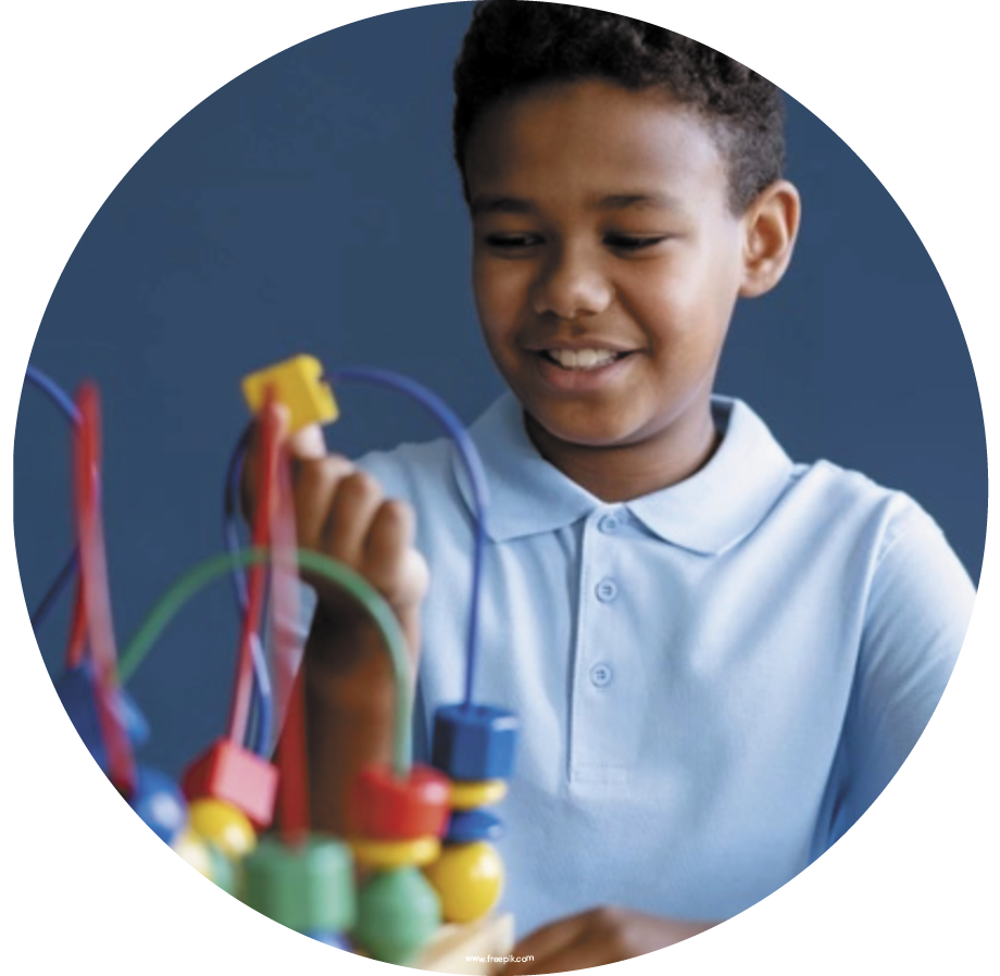 ABA Therapy Methodology Basics blog. Image of a young boy playing with a toy.